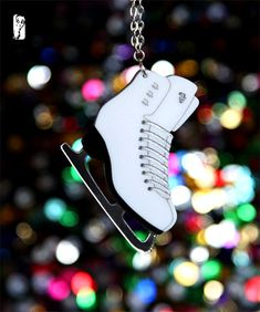 Hey, I found this really awesome Etsy listing at https://www.etsy.com/listing/116888161/ice-skate-necklace-dancing-on-ice