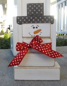 snowman out of wooden blocks