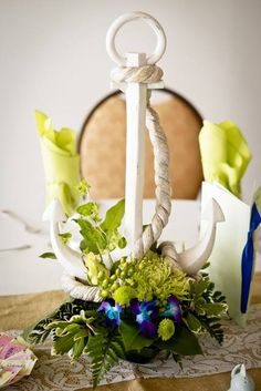 I just love this #anchor #centerpiece. What do you think? I found this picture from The Pavilion at Sunken Meadow #Nautical #Reception #Wedding http://foreverfriendsfinestationeryandfavors.com