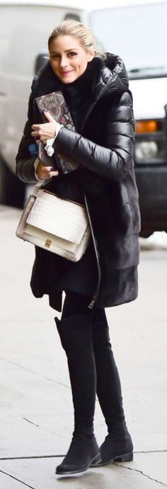 Who made Olivia Palermo's black down coat, suede thigh high boots, and handbag?