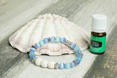 This listing is for one blue and green glass and white lave bead essential oil diffuser bracelet. Glass beads are 8 mm in diameter, white lava beads are 10 mm in diameter, and the bracelet is made with a hypoallergenic cord. The accents are silver plated and are individually