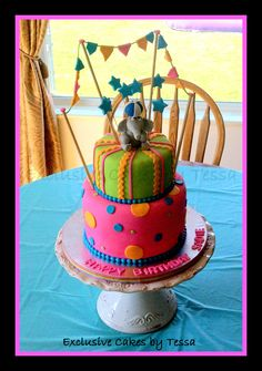 Circus / Carnival themed fondant birthday cake with fondant elephant balancing a ball. By Exclusive Cakes by Tessa