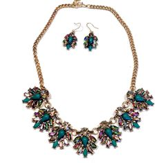 Glad Girls only wants your attention.  Perfect to spice up a work suit or a cocktail dress. Glad girls has the trendy mix of smoke and peacock colored rhinestones in an aged gold setting.   Vintage in style but modern in colors. Glad Girls wants you to look as good as you feel.  Necklace is... #SweetSangria #jewelry #trending #eyecandy #unique #boho #accessories #fashion #coolmom #womensjewelry
