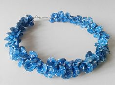 handmade polymer clay necklace with blue petals