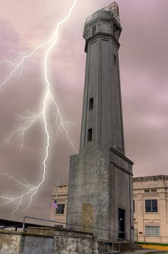 Alcatraz Lighthouse on Alcatraz Island, San Francisco Bay, with an appropriate streak of lightning. This lighthouse is about as bleak as the prison. San Francisco, Fuerza Natural, Jolie Photo, Abandoned Places, Places To See, Beautiful Places, Around The Worlds, Island, Pictures