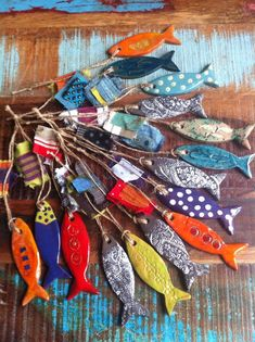 Colourful ceramic. What wonderful little fishes... i have got to make these for the beach hut