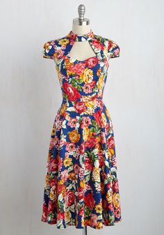 You've learned many lessons in your fashion explorations, but the most crucial were those gained from this blue dress. Its cap sleeves and bodice cutouts taught you the importance of a retro aesthetic, while its gorgeous florals and midi-length skirt showed you that you can make any style your own!