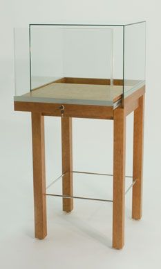 GL134 Square Museum Pedestal Display Case Shown in Light Cherry Wood Veneer