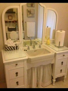 A dressing table was used to be the surround for a stand alone pedestal sink for a most lovely vintage cottage look!