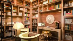 This incredible home library wall unit has book shelving for the entire collection plus a spot to sit and read. Small desk allows for note taking and cataloging the collection. Traditional style in wood with dental crown and lion onlays.