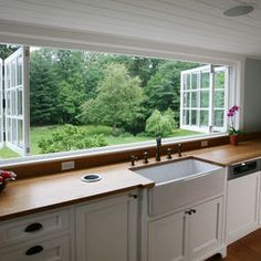 One long window for above the kitchen sink/counter. This is stunning! So open and a great view (: