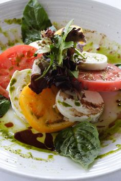 Insalata Caprese: 4 sliced vine ripened red beefsteaks, thick cut with fresh mozzarella, aged balsamic, and an infused basil oil.