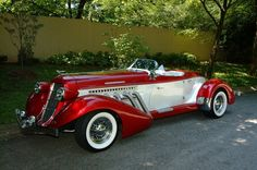 The 1936 Auburn Boattail Speedster. A roadster with a V-12. Proportion of the car's snout is unbelievable. All engine.