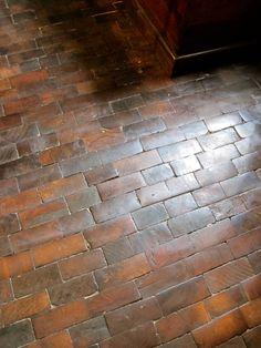Wood floor, looks like brick
