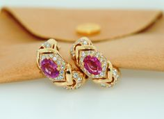 """BULGARI Gorgeous Diamond & Pink Sapphire Earrings from Bvlgari Alveare Collection. Set in 18K Yellow Gold with 2.00 carat pink sapphire and 1.25 carat diamonds. Post Back & Clip-on ( post can be removed ). Signed """"Bvlgari"""" 750. Accompanied with Bvlgari Earring Pouch. - 7.5k USD"""