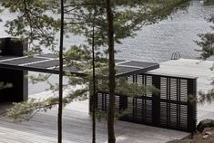 Blackened wood covers this guest cabin and boathouse, which Atelier Kastelic Buffey has designed alongside a deck for diving into an Ontario lake. Kitchenette, Journal Du Design, Guest Cabin, Wood Siding, Exterior Siding, Waterfront Property, Cottage Design, Concrete Floors, New Wave