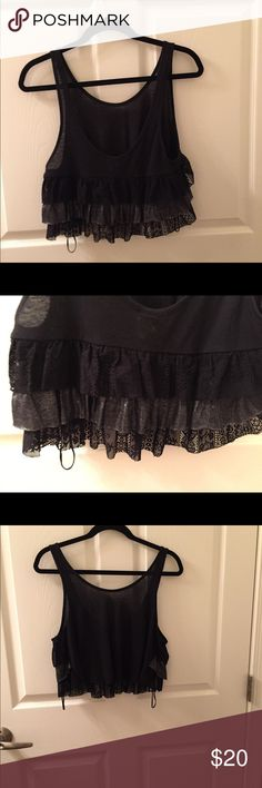 Free People Ruffle Crop Top Cute black crop top with ruffles. I got this off another app, never wore it. I don't like this style on me.  Ruffles could be worn in the front or the back - your choice 😍.  Top has never been worn, just waiting for someone to love it.  💞Not firm on price for this item💞 Free People Tops Crop Tops
