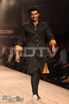 Lakme Fashion Week: Ishaqzaade Arjun Kapoor was handsome in a black kurta pyjama as he walked the ramp for designer Kunal Rawal. The actor also performed on uncle Anil Kapoor's hit song Ram Lakhan at the show.