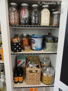 Mason jars and baskets organize pantry supplies