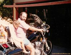 """""""My dad loved motorcycles. This is him on his Yamaha with me in back and my 2 yr old brother bungee corded to the seatback.""""  (submitted by Miranda)"""