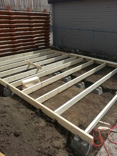 He started building the foundation of the deck with additional 4x4s, then laid the deck boards on top.