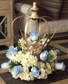 Crown Centerpiece, Decorative Crown painted gold and filled with flowers for royal baby boy shower centerpiece! Crowns at www.crownchic.com