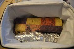 Keep food hot with a hot brick and foil inside your insulated cooler. Perfect for tailgating!!