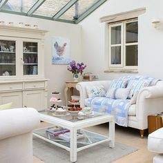 The neutral backdrop in this conservatory creates a feeling of space, plus it's easy to add colour with cushions and throws.