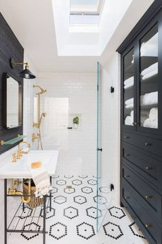 Black Accent Pieces with Bright White tiles and lighting