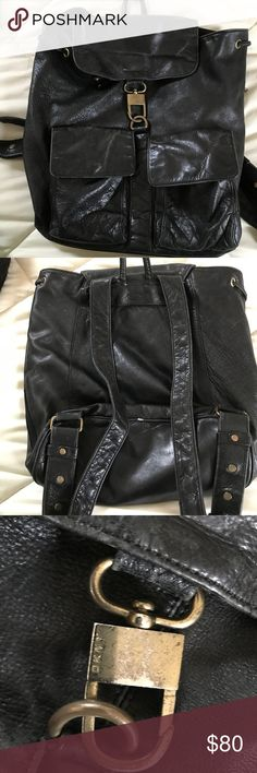 """DKNY BACKPACK! Soft leather DKNY Used Backpack. This backpack is worn in to the coolest possible """"worn look """"new"""" backpacks! There are scratches on the gold color closure. 9.5""""L x 12""""H x 5""""W Super cute, used condition, black, soft leather (but nice thickness to it) small backpack. Leather has some aging signs( bottom corners, pull leather string, pockets corners) but not very visible and normal with leather. Exterior has 2 front pocket, interior has 1 zipper pocket. Zipper on the side of the…"""