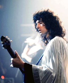 Queen: Brian May, Rainbow Theatre, March 1974. He looks like both a god and an angel!