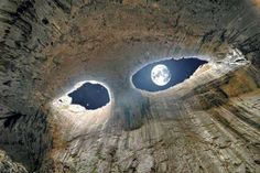 """The Eyes of God"" -Prohodna Cave, Bulgaria (Source, I believe)  This is the full moon from inside a cave. It looks like two eyes staring down at you; beautiful."