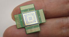 picture of sensor chip resting on two fingers