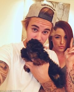 Justin, Esther, and a fan posing for a picture (tbfh, they would look cute together)