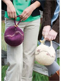 Wool and llama fibers in a singles yarn felt beautifully to make these bags. With a simple top-down construction and free-form embroidery applied before felting, these sturdy, delightfully plump little bags can hold some knitting, purse necessities, or