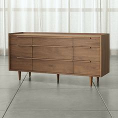 The horizontal dresser presents a continuous front with nine drawers of varying size. Designed by Blake Tovin, the Tate Chest is a Crate and Barrel exclusive.