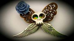Butterfly skull brooch