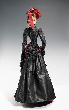 """1878 Doll""  House of Lanvin  (French, founded 1889)  Designer: Marie-Blanche di Pietro (French, 1897–1958) Date: 1949 Culture: French Medium: metal, plaster, silk, feather Dimensions: 34 x 15 in. (86.4 x 38.1 cm) Credit Line: Brooklyn Museum Costume Collection at The Metropolitan Museum of Art, Gift of the Brooklyn Museum, 2009; Gift of Syndicat de la Couture de Paris, 1949 Accession Number: 2009.300.709a–f"