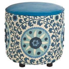 """Add a pop of visual interest to your living room seating group or den ensemble with this eye-catching ottoman, showcasing cotton upholstery with a cosmopolitan suzani-inspired motif and faux leather details.   Product: OttomanConstruction Material: Cotton, faux leather and woodColor: BlueFeatures: Block feetDimensions: 19"""" H x 19"""" DiameterCleaning and Care: Professional cleaning recommended"""