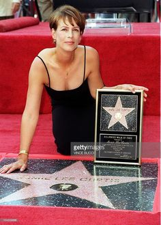 US actress Jamie Lee Curtis poses after being honored with a star on the 'Walk of Fame' during a ceremony 03 September 1998 in Hollywood, CA. Curtis joins her famous mother, actress Janet Leigh, and her father, actor Tony Curtis, who also have stars on the legendary sidewalks of Hollywood Boulevard. AFP PHOTO Vince BUCCI