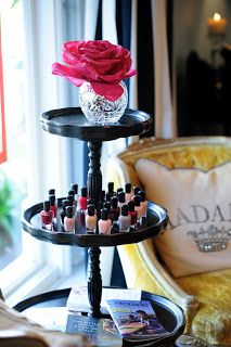 display nail polish on a cake stand
