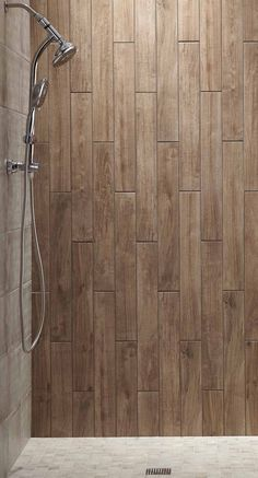 The shower wall  features Montagna in Soft Maple 4x 28.