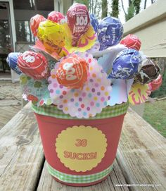 This fun gift is perfect for any milestone birthday and it's easy to make with a craft punch, suckers and an inexpensive flower pot