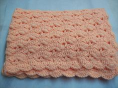 Baby blanket I crocheted with Lion Brand pound of love yarn in peach.
