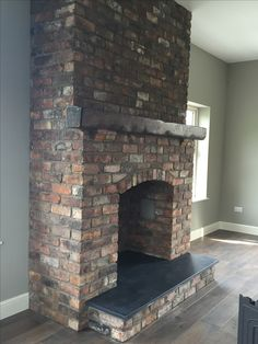 Reclaimed brick feature fireplace with Kilkenny limestone hearth. Reclaimed Belfast bricks from Period Homes NI