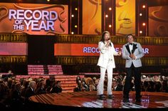 Steven Tyler and Smokey Robinson present the GRAMMY for Record Of The Year on the 56th Annual GRAMMY Awards on Jan. 26 in Los Angeles