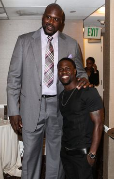 This one's simple:Kevin Hart is O'Neal is this is how that math shakes out in photo form:Now let's look at that through Shaq's point of view:And from Hart's perspective:These guys would make terrible slow dance partners. Short Girls, Girls Out, Cute Girls, Black Power, Short People Problems, King Of Queens, Tall People, Partner Dance, Slow Dance
