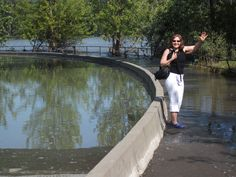 Debbie standing beside Front Street in Quesnel a week after the rivers stopped rising. That's the Quesnel River behind her, and yes she is standing beside the barrier that separates the road (covered by water) from the shoulder. July 2012