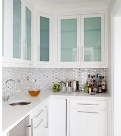 Love the backsplash. It's like confetti in the kitchen! Design by Morgan Harrison Home.
