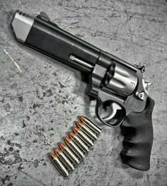 The Smith & Wesson Performance Center 627 V Comp .357 MAG 8 Shot Revolver. Pure American Metal.